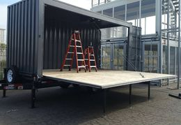 A fold-down container/stage mounted on a trailer